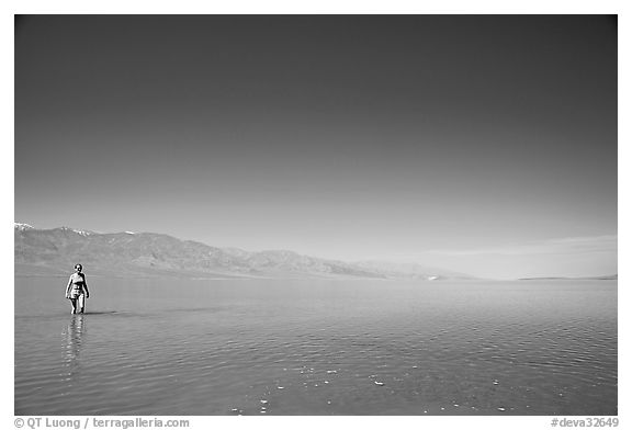 Woman wading in Manly Lake. Death Valley National Park (black and white)