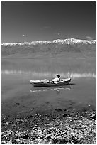 Salt formations, kayaker, and Panamint range. Death Valley National Park ( black and white)