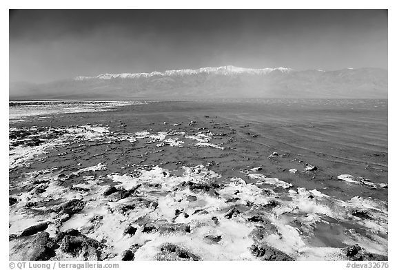 Salt formations and Manly Lake, morning. Death Valley National Park (black and white)