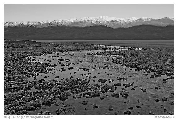 Salt pool and sunrise over the Panamints. Death Valley National Park (black and white)