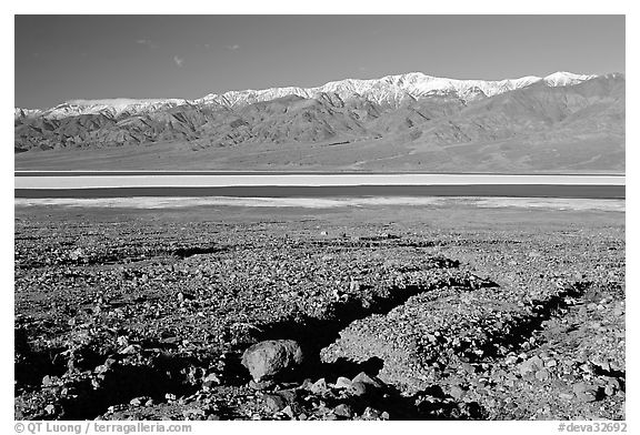 Valley with seasonal lake in the distance and Panamint Range, morning. Death Valley National Park (black and white)