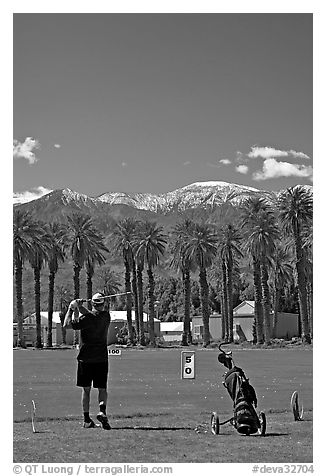 Golfer in Furnace Creek Golf course. Death Valley National Park (black and white)