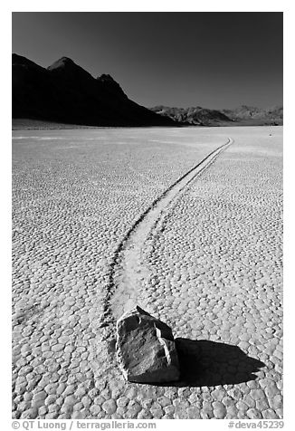 Sailing rock and travel groove on the Racetrack. Death Valley National Park (black and white)