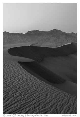 Sand dunes and Amargosa Range at dusk. Death Valley National Park (black and white)
