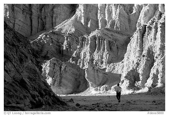 Hikers surrounded by tall walls in Golden Canyon. Death Valley National Park (black and white)