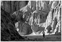Hikers surrounded by tall walls in Golden Canyon. Death Valley National Park ( black and white)