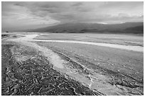 Mud patterns and dried salt rivers, Cottonball Basin. Death Valley National Park ( black and white)
