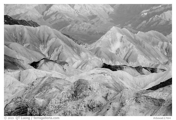Badlands and mountain lighted by sunrise, Twenty Mule Team Canyon. Death Valley National Park (black and white)