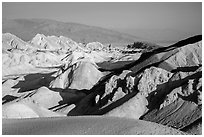 Twenty Mule Team Canyon and distant valley. Death Valley National Park ( black and white)