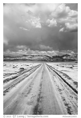 Straight road through Salt Pan. Death Valley National Park (black and white)