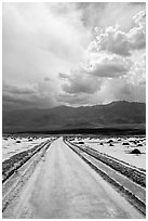 Road crossing Salt Pan. Death Valley National Park ( black and white)