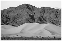 Ibex Dunes and Saddle Peak Hills at sunset. Death Valley National Park ( black and white)