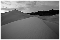 Ibex Sand Dunes and mountains at dusk. Death Valley National Park ( black and white)