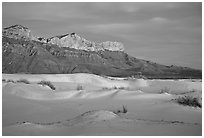 White gyspum sand dunes and cliffs of Guadalupe range at dusk. Guadalupe Mountains National Park, Texas, USA. (black and white)