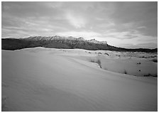 White gypsum dunes and Guadalupe range at sunset. Guadalupe Mountains National Park ( black and white)