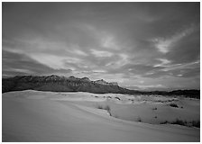 White sand dunes, Guadalupe range, and clouds at sunset. Guadalupe Mountains National Park, Texas, USA. (black and white)