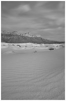 Gypsum sand dunes and Guadalupe range at sunset. Guadalupe Mountains National Park, Texas, USA. (black and white)