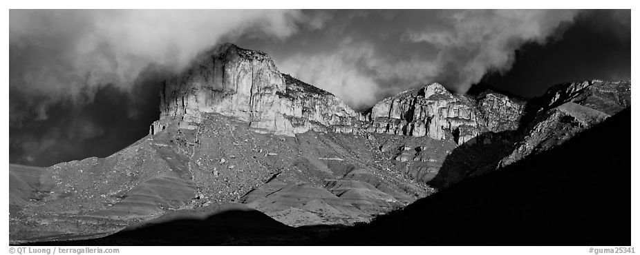 Cliffs and clouds illuminated by low sun. Guadalupe Mountains National Park (black and white)