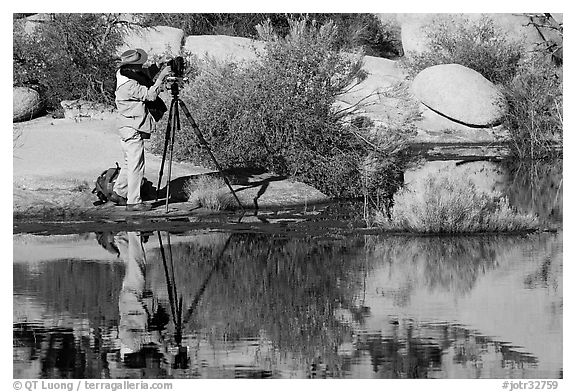 Photographer with large format camera at Barker Dam. Joshua Tree National Park (black and white)