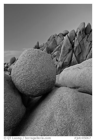Spherical granite boulder and angular rocks, twilight. Joshua Tree National Park (black and white)