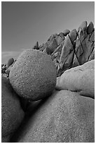 Spherical granite boulder and angular rocks, twilight. Joshua Tree National Park ( black and white)
