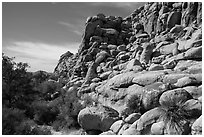 Towering rock formations around Hidden Valley. Joshua Tree National Park ( black and white)