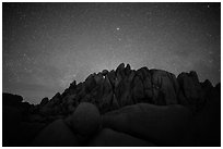 Geometrically shaped rocks and clear starry sky. Joshua Tree National Park ( black and white)