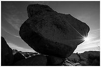 Balanced Rock with sunstar. Joshua Tree National Park ( black and white)