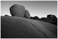 Twin boulders and crack at sunrise. Joshua Tree National Park ( black and white)
