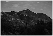 Rincon Peak at night with star trails. Saguaro National Park ( black and white)