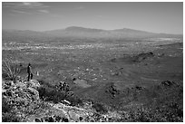 Visitor looking, Wasson Peak overlooking Tucson. Saguaro National Park ( black and white)