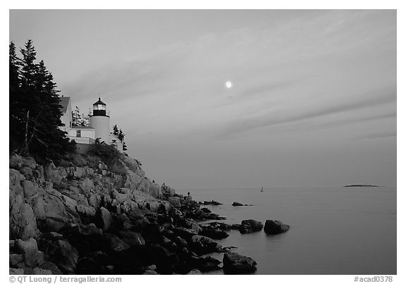 Bass Harbor lighthouse on rocky coast, sunset. Acadia National Park (black and white)