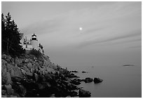 Bass Harbor lighthouse on rocky coast, sunset. Acadia National Park, Maine, USA. (black and white)
