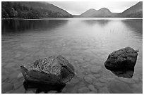 Two boulders in Jordan Pond on foggy morning. Acadia National Park, Maine, USA. (black and white)