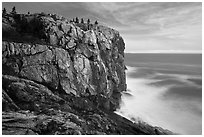 Sea cliff and blurred ocean water. Acadia National Park ( black and white)