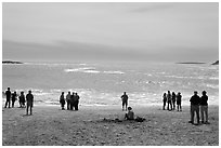 People looking at ocean from Sand Beach. Acadia National Park, Maine, USA. (black and white)