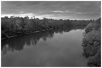 Congaree River under storm clouds at sunset. Congaree National Park ( black and white)