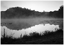 Mist raising from Kendall Lake at sunrise. Cuyahoga Valley National Park, Ohio, USA. (black and white)