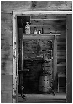 Room seen through doorway inside cabin, Cades Cove, Tennessee. Great Smoky Mountains National Park, USA. (black and white)