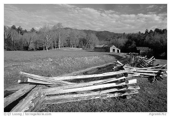 Wooden fence, pasture, and cabin, late afternoon, Cades Cove, Tennessee. Great Smoky Mountains National Park (black and white)
