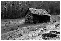 Jim Bales log Cabin in meadow, early morning, Tennessee. Great Smoky Mountains National Park, USA. (black and white)