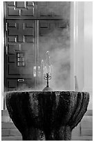Fountain with thermal steam outside Park Visitor Center. Hot Springs National Park, Arkansas, USA. (black and white)