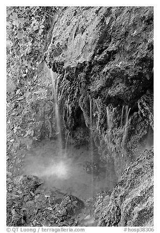 Water from hot springs flowing over tufa rock. Hot Springs National Park (black and white)