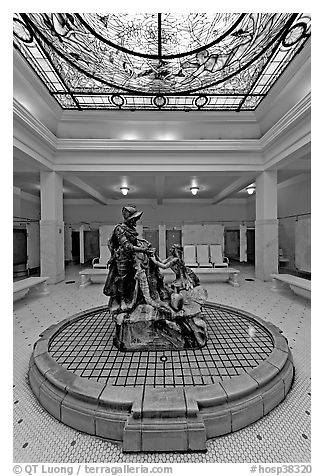 Statue of Desoto receiving gift from Caddo Indian maiden in mens bath hall. Hot Springs National Park (black and white)