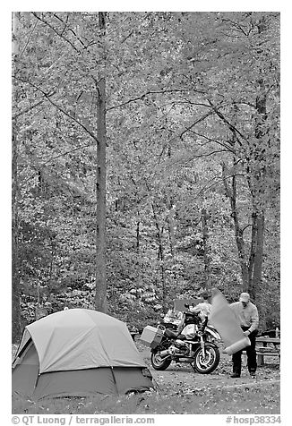 Tent and motorcycle camper under trees in fall colors. Hot Springs National Park (black and white)
