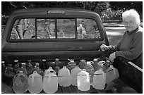 Resident stocks up on natural spring water. Hot Springs National Park, Arkansas, USA. (black and white)