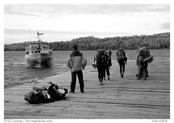 Backpackers waiting for pick-up by the ferry at Windego. Isle Royale National Park (black and white)