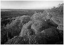 Mount Franklin granite outcrop and distant Lake Superior at sunset. Isle Royale National Park, Michigan, USA. (black and white)