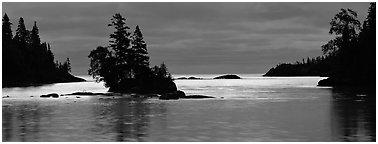 North woods lakescape with silhouetted trees. Isle Royale National Park (Panoramic black and white)