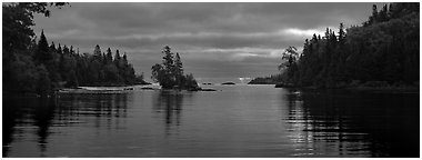 Cloudy sunrise on north woods lake. Isle Royale National Park (Panoramic black and white)
